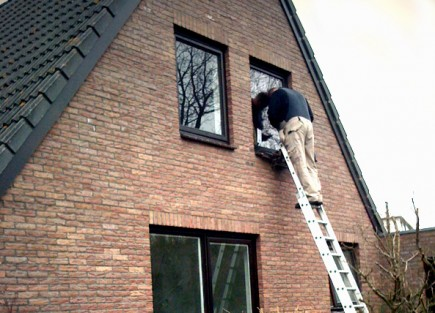 glaszetter op ladder